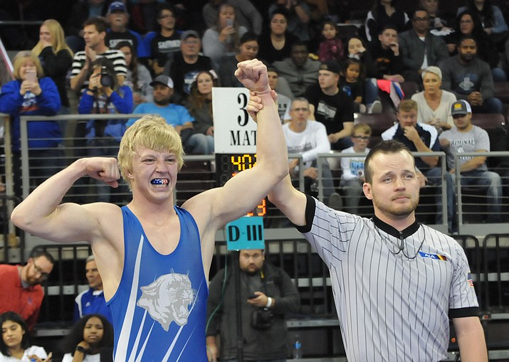 Chino Valley's Keller Rock gets his hand raised after defeating Safford's Robert White in the Division III 170-pound state championship match at the Findlay Toyota Center on Friday, Feb. 8, 2019. (Chris Whitcomb/Courier)