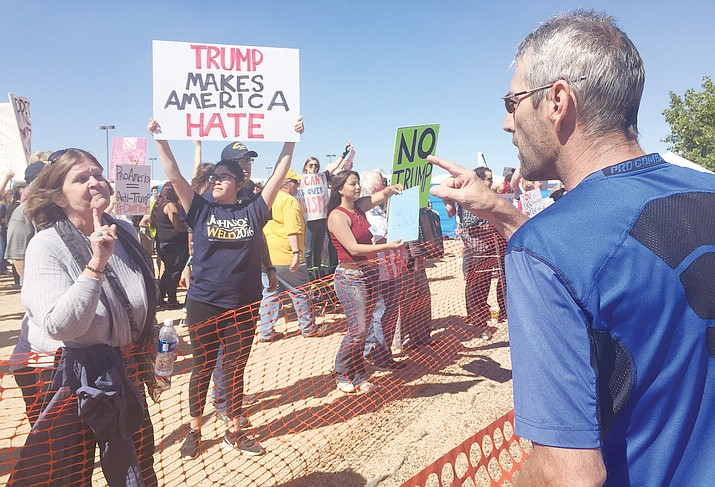Protesters and supporters get into some finger wagging at the Donald Trump for President Rally at the then-Prescott Valley Event Center on Tuesday, Oct. 4, 2016. Trump visited the Prescott area during his campaign. (Cindy Barks/Courier, file)