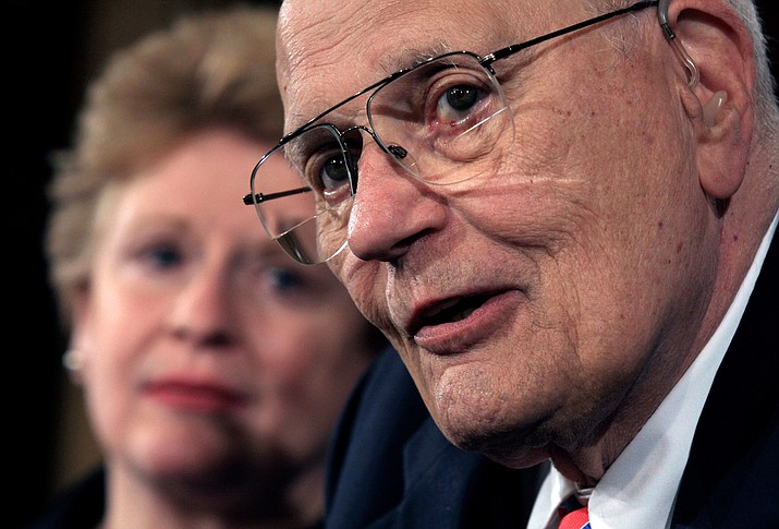 In this 2008 file photo, House Energy and Commerce Committee Chairman Rep. John Dingell, D-Mich., accompanied by Sen. Debbie Stabenow, D-Mich., meets with reporters on Capitol Hill in Washington. (Lauren Victoria Burke/AP)