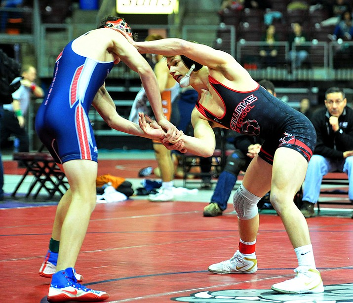 Lee Williams' Jimmy Wayman, right, defeated Talon Norton in the first round of the Division III State Championship at the Findlay Toyota Center in Prescott Valley. (Photo by Les Stukenberg/Daily Courier)