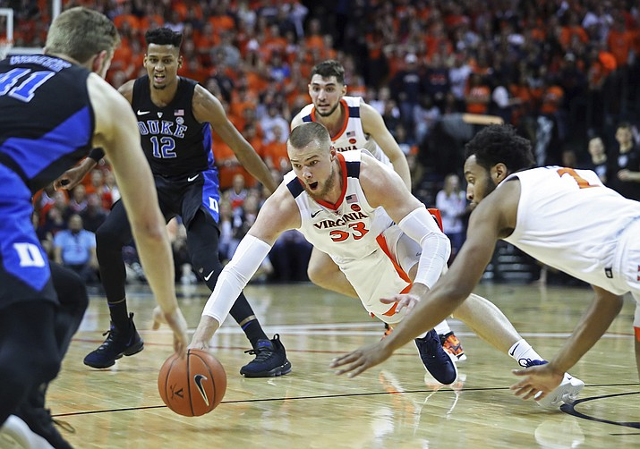 Virginia center Jack Salt (33) dives for a loose ball during the first half of the team's game against Duke on Saturday, Feb. 9, 2018, in Charlottesville, Va. (Zack Wajsgras/AP)
