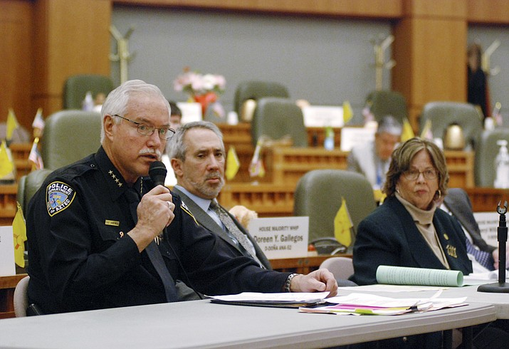 Mike Heal, left, police chief for the city of Aztec, N.M., testifies Monday, Feb. 4, 2019, in support of a state bill that would take away guns temporarily under court orders from people who are considered a danger to themselves or others, in Santa Fe, N.M. Heal says the bill from Democratic state Reps. Daymon Ely, center, and Joy Garratt, right, provides a new tool to keep school students safe. (Morgan Lee/AP)