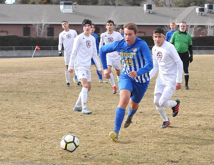 Badgers senior midfielder Jack Gould pushes the ball up the field during Prescott's first-round playoff game against Walden Grove Saturday, Feb. 9, at Bill Shepard Field. (Doug Cook/Courier)