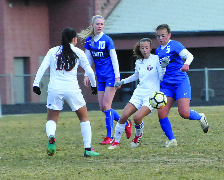 Badgers senior midfielder Sydney Seeley (No. 5) jockeys for possession of the ball with a Poston Butte player while Prescott junior midfielder Sawyer Magnett (No. 10) looks on Saturday, Feb. 9, at Bill Shepard Field. (Doug Cook/Courier)