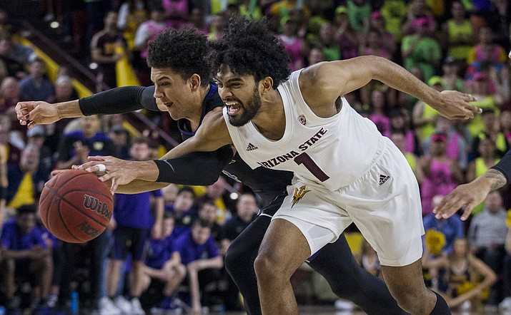 Arizona State's Remy Martin, right, reaches the ball with Washington's Matisse Thybulle during the second half of an NCAA college basketball game Saturday, Feb. 9, 2019, in Tempe, Ariz. Arizona State won 75-63. (Darryl Webb/AP)