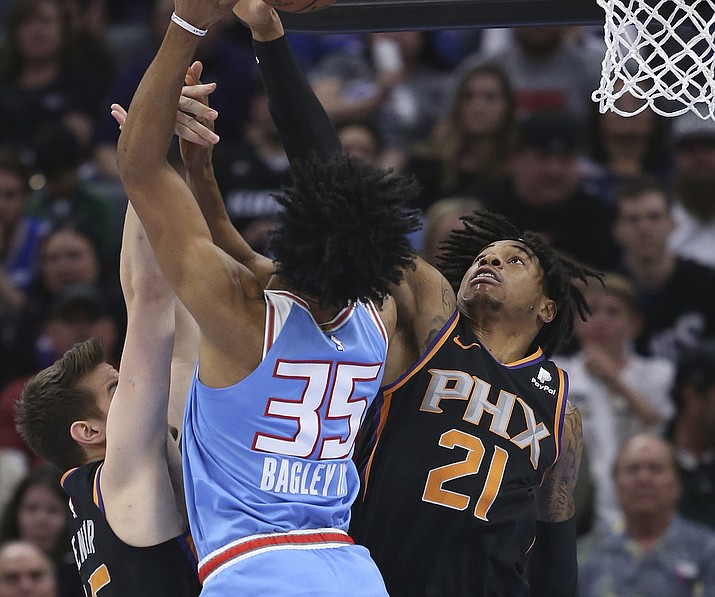 Sacramento Kings forward Marvin Bagley III, left, is fouled by Phoenix Suns forward Richaun Holmes, right, as he goes to the basket during the first half of an NBA basketball game Sunday, Feb. 10, 2019, in Sacramento, Calif. (Rich Pedroncelli/AP)