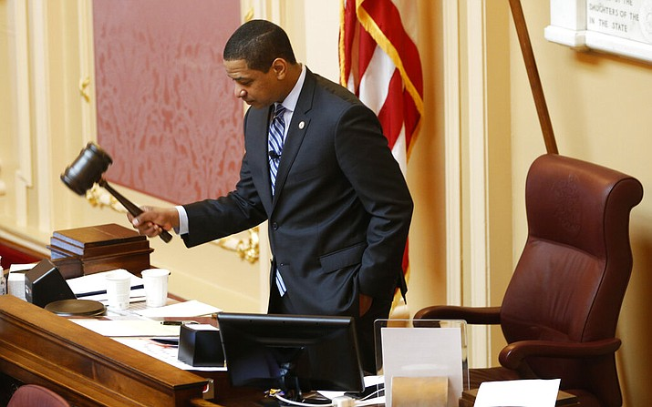 Virginia Lt. Gov. Justin Fairfax, gavels the session to order at the start of the Senate session at the Capitol in Richmond, Va., Friday, Feb. 8, 2019. An effort to impeachFairfax was prompted by the emergence of two women who accused him of sexual assault in the 2000s. (AP Photo/Steve Helber)