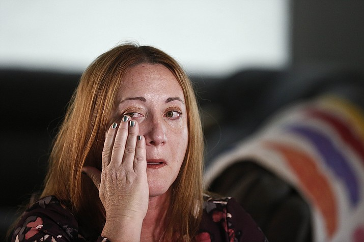 Lori Alhadeff, mother of 14-year-old Alyssa Alhadeff who was one of 17 people killed at Marjory Stoneman Douglas High School, wipes away a tear as she cries while talking about her daughter on Wednesday, Jan. 30, 2019, in Parkland, Fla. (AP Photo/Brynn Anderson)