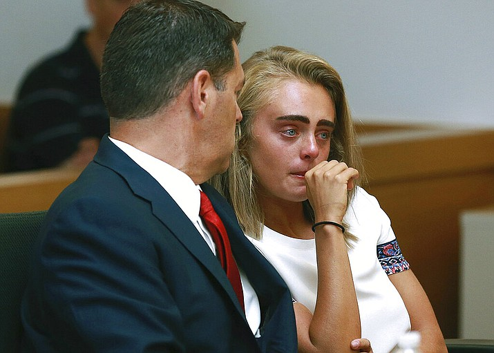 In a Thursday, Aug. 3, 2017 file photo, Michelle Carter awaits her sentencing in a courtroom in Taunton, Mass., for involuntary manslaughter for encouraging Conrad Roy III to kill himself in July 2014. Prosecutors are asking a judge to order Michelle Carter to begin serving her 15-month jail sentence for encouraging her suicidal boyfriend to kill himself. Michelle Carter will appear in court Monday, Feb. 11, 2019 for a hearing to consider prosecutors' request. (Matt West/The Boston Herald via AP, Pool, File)