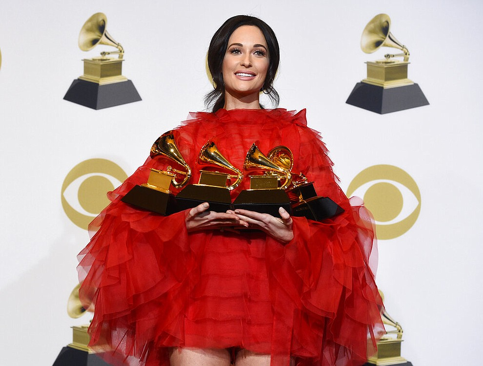 """Kacey Musgraves, winner of the awards for best country album for """"Golden Hour"""", best country song for """"Space Cowboy"""", best country solo performance for """"Butterflies"""" and album of the year for """"Golden Hour"""" poses in the press room at the 61st annual Grammy Awards at the Staples Center on Sunday, Feb. 10, 2019, in Los Angeles. (Photo by Chris Pizzello/Invision/AP)"""