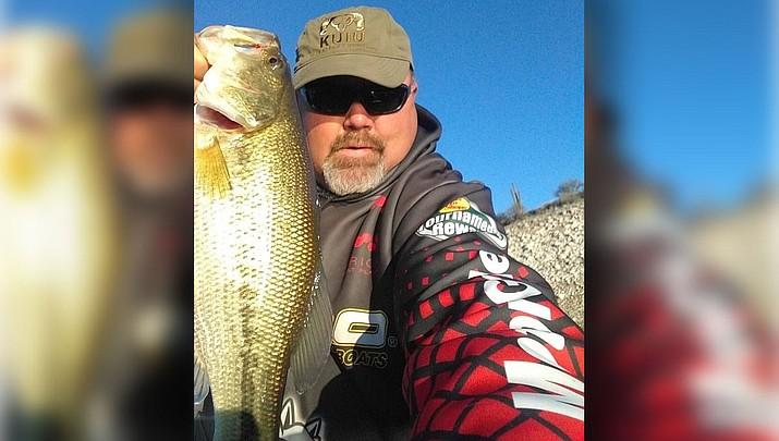 Kingman resident Donnie Scroggins holds a bass he caught at Bartlett Lake. (Courtesy)