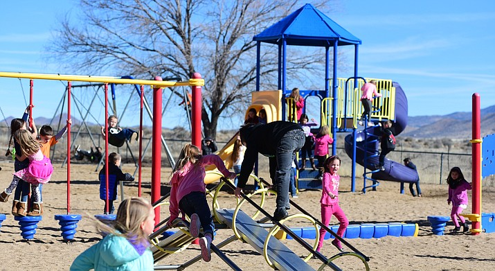 Students at Coyote Springs Elementary School hit the playground for their morning recess Feb. 1, 2017, in Prescott Valley. The results of legislation last year that requires more recess or unstructured playtime for children in Arizona are promising. (Les Stukenberg/Courier, file)