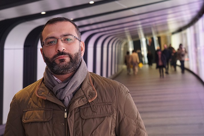 Mazen Masri, an academic and a consultant to the legal team suing the NSO Group in Israel over alleged abuses involving its spyware, poses for a photograph in a pedestrian underpass leading to King's Cross Station in London on Monday, Jan. 27, 2019. He is among half a dozen people who have been approached by undercover operatives on false pretexts over the past two months. All six have crossed paths with the NSO Group in some way. (Raphael Satter/AP)