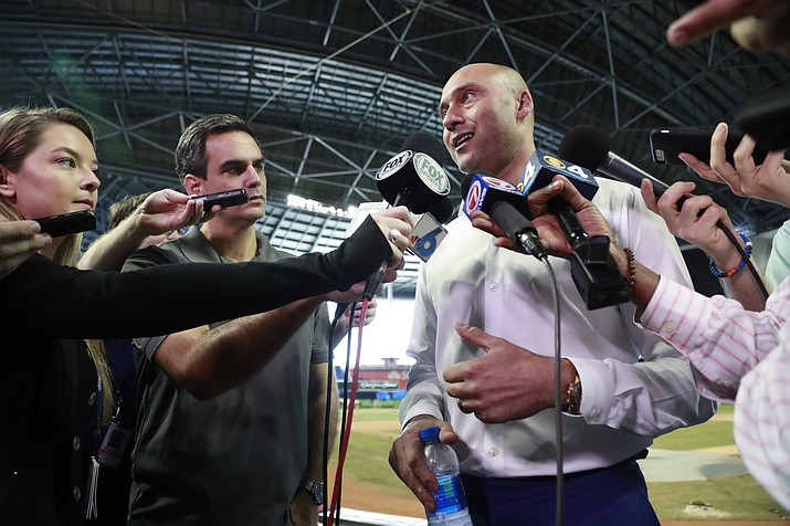 Miami Marlins baseball team CEO Derek Jeter, right, speaks to members of the media inside Marlins Park stadium, Monday, Feb. 11, 2019, in Miami. Jeter is entering his second season as CEO of the Marlins, who remain in the throes of a rebuilding project. (Wilfredo Lee/AP)