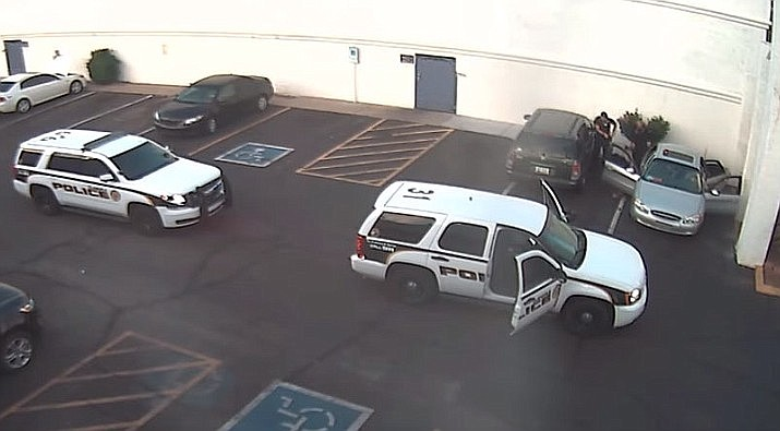 Glendale Police officers, top right, use a taser on a man after he questioned why he had to provide identification. The man and his wife are suing the Phoenix suburb and three of its police officers, alleging they used excessive force during a 2017 traffic stop. (Glendale Police Facebook video screenshot)