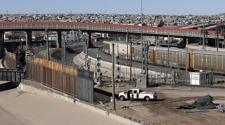 In this Tuesday, Jan. 22, 2019, photo, a new barrier is built along the Texas-Mexico border near downtown El Paso. Such barriers have been a part of El Paso for decades and are currently being expanded, even as the fight over President Donald Trump's desire to wall off the entire U.S.-Mexico border. (AP Photo/Eric Gay)