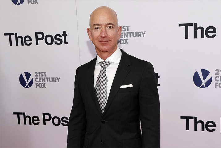 """In this Dec. 14, 2017, file photo, Jeff Bezos attends the premiere of """"The Post"""" at The Newseum in Washington. Private investigators working for Bezos have determined the brother of the Amazon CEO's mistress leaked the couple's intimate text messages to the National Enquirer. (Photo by Brent N. Clarke/Invision/AP)"""