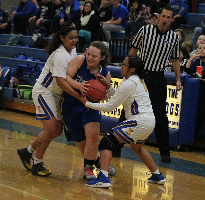 Kingman's Star Talayumpteua, left, and Sienna Silas try to steal the ball from Kingman Academy's 