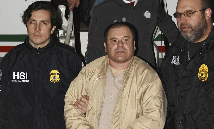 "Authorities escort Joaquin ""El Chapo"" Guzman, center, from a plane to a waiting caravan of SUVs on Jan. 19, 2017, at Long Island MacArthur Airport in Ronkonkoma, N.Y. The notorious Mexican drug lord was convicted of drug-trafficking charges, Tuesday, Feb. 12 2019, in federal court in New York. (United States Drug Enforcement Administration via AP)"