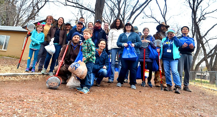 Volunteers pose for a photo after the great pecan pick-up after combing a Cottonwood neighborhood. VVN/Vyto Starinskas