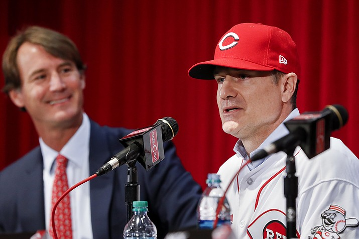 Cincinnati Reds manager David Bell, right, speaks alongside Dick Williams, president of baseball operations, left, during a news conference Oct. 22, 2018, in Cincinnati. Bell has been hired as manager of the Cincinnati Reds, tasked with helping turn around a team that skidded to a 67-95 record and last-place finish in the NL Central. (John Minchillo/AP, file)