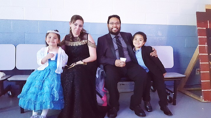 A family enjoys the Royal Ball put on by the Williams Parent Teacher Organization for Williams Elementary-Middle School students Feb. 7. (Photo/Williams Elementary-Middle School)