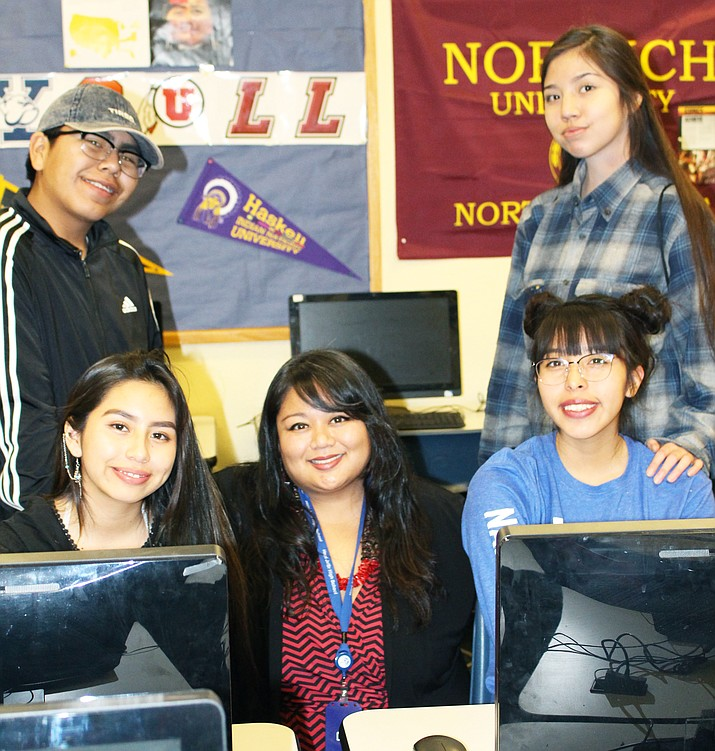 "Mariquit ""Kit"" Palabyab (center), the new Native American studies teacher at Hopi Jr/Sr High School poses with Hopi High students Quaidin Ben, Brooky Harding, Olivia Adams and Mariah Namingha. (Stan Bindell/NHO)"