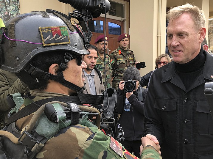 Acting Secretary of Defense Pat Shanahan greets an Afghan commando at Camp Commando, Afghanistan on Monday, Feb. 11, 2019. The unannounced visit is the first for the acting secretary of defense, Pat Shanahan. He previously was the No. 2 official under Jim Mattis, who resigned as defense chief in December. (Robert Burns/AP)