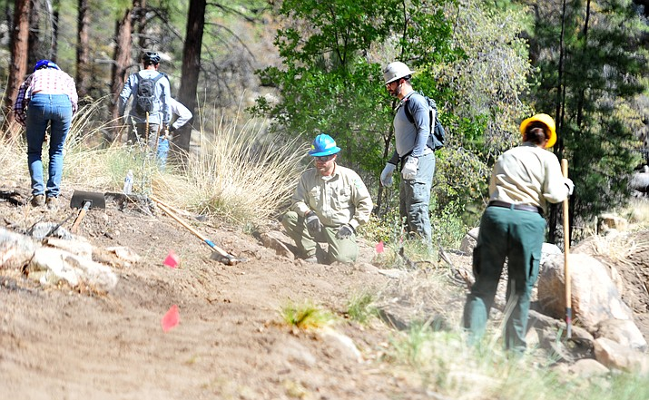 Prescott National Forest Trails and Wilderness Manager Jason WIlliams helps a group as over 50 volunteers came out to the Spence Basin trail system to help the Prescott National Forest as part of National Trails Day May 19, 2018, in Prescott. (Les Stukenberg/Courier,file)