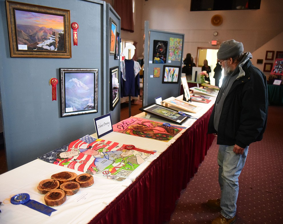 USAF vietnam veteran Roger Anderson looks at some of the artwork on display at the Prescott VA Veteran's Creative Arts Festival Wednesday, Feb. 13, 2019. 128 pieces are on display at the 25th annual show being held in Building 15, theatre. (Les Stukenberg/Courier).