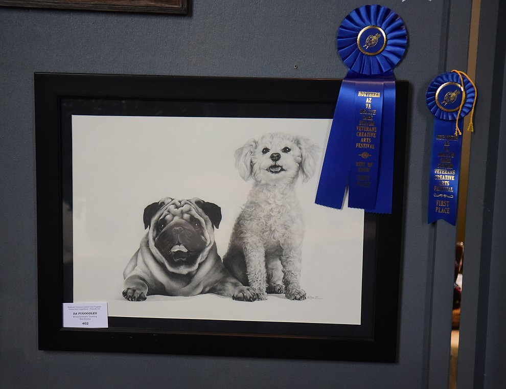 Da Pugoodles a monochromatic drawing by Ron Errera won Best in Show at the Prescott VA Veteran's Creative Arts Festival Wednesday, Feb. 13, 2019. 128 pieces are on display at the 25th annual show being held in Building 15, theatre. (Les Stukenberg/Courier).