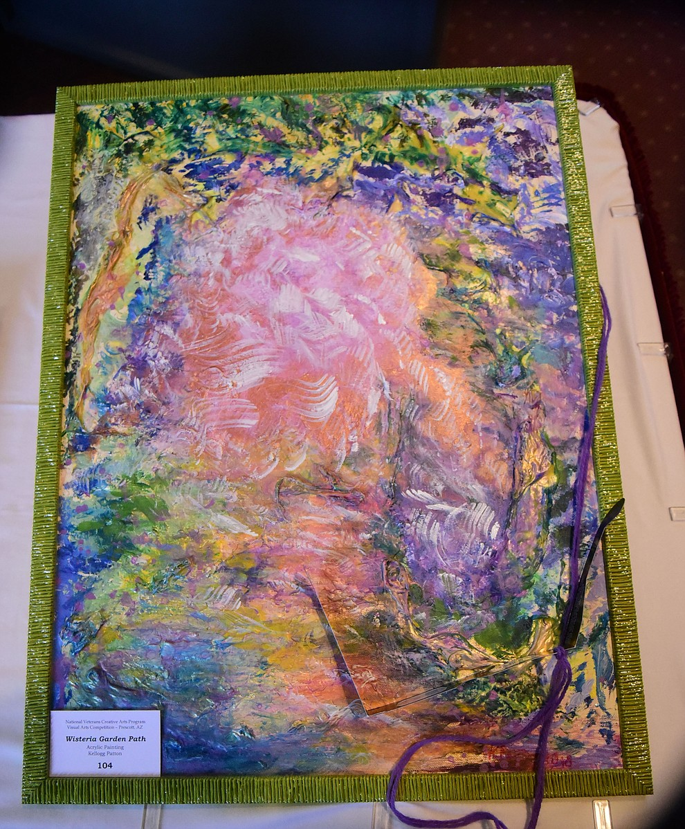 Kellogg Patton's acrylic painting Wisteria Garden Path on display at the Prescott VA Veteran's Creative Arts Festival Wednesday, Feb. 13, 2019. 128 pieces are on display at the 25th annual show being held in Building 15, theatre. (Les Stukenberg/Courier).