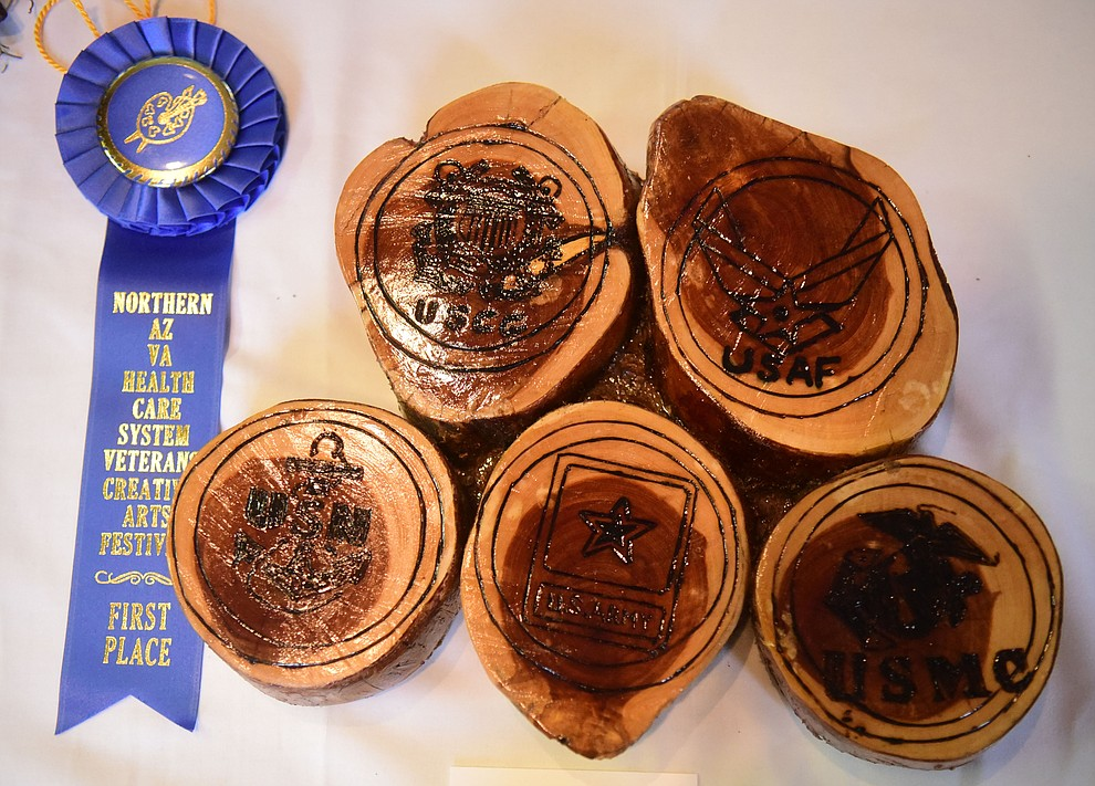 What a Great Place to Start pyrography by Tommy Wood on display at the Prescott VA Veteran's Creative Arts Festival Wednesday, Feb. 13, 2019. 128 pieces are on display at the 25th annual show being held in Building 15, theatre. (Les Stukenberg/Courier).