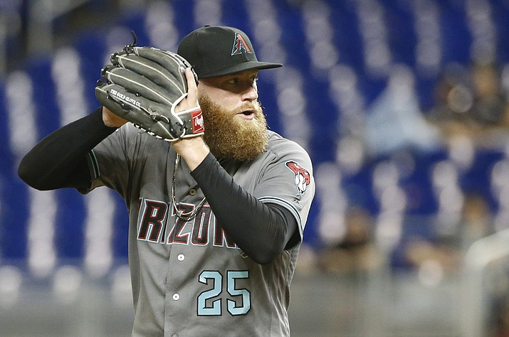 Arizona Diamondbacks' Archie Bradley delivers a pitch during the seventh inning of a baseball game against the Miami Marlins, Tuesday, June 26, 2018, in Miami. The Diamondbacks defeated the Marlins 5-3. (Wilfredo Lee/AP, file)