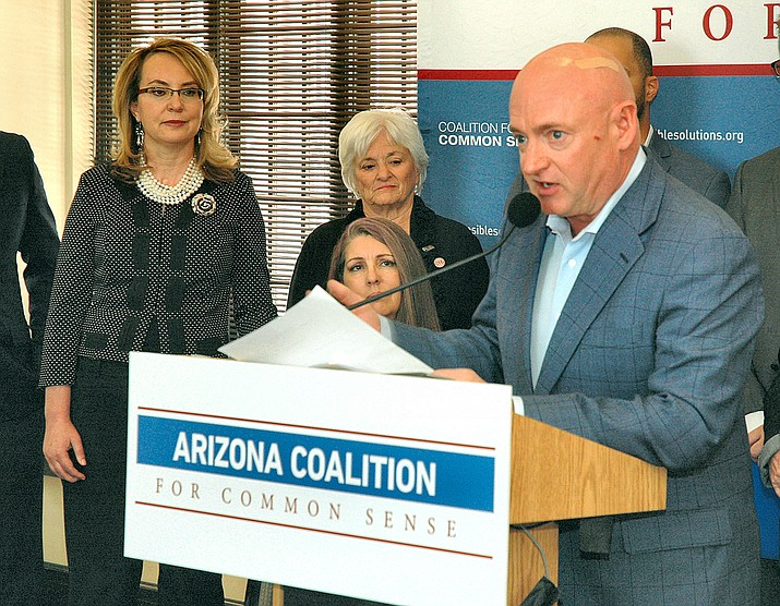 Former astronaut and now Senate contender Mark Kelly at a 2017 news conference in Phoenix urging Arizona lawmakers to elect reasonable gun restrictions. With him is his wife, former Congresswoman Gabrielle Giffords. (Howard Fischer/Capitol Media Services/)