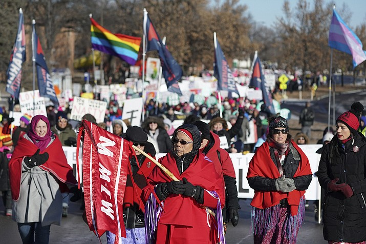 In this Jan. 19, 2019 file photo Rene Ann Goodrich, of Superior with Missing and Murdered Indigenous Women, leads the procession though the streets of St. Paul during the Women's March at the State Capitol in St. Paul, Minn. Lawmakers in at least seven states have introduced legislation to address the unsolved deaths and disappearances of numerous Native American women and girls. (Anthony Souffle/Star Tribune via AP, file)