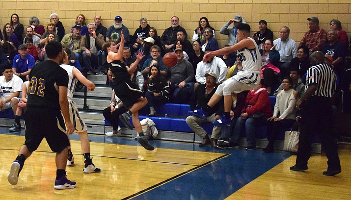 Camp Verde junior Abe Gonzalez throws the ball off of a Spartan after getting  a steal during the Cowboys' 76-72 loss to Gilbert Classical at home on Tuesday night in the state play-in game. VVN/James Kelley