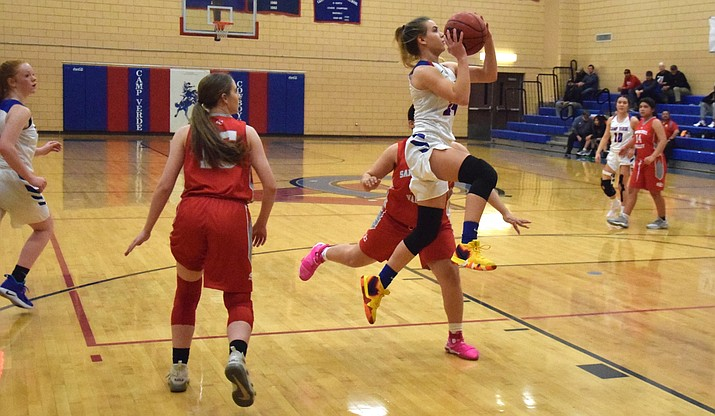 Camp Verde junior Tanna Decker scores a couple points during the Cowboys' 68-40 win over Santa Cruz Valley at home on Tuesday night in the state play-in game. VVN/James Kelley