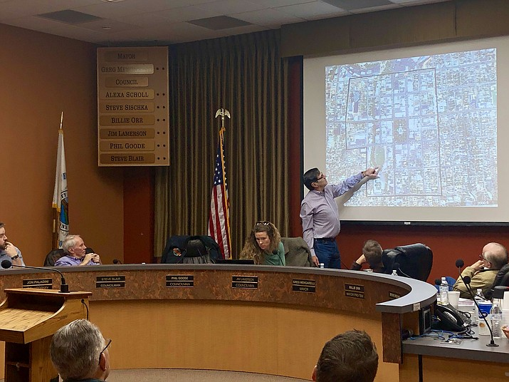 Mike Fann, a member of the Mayor's Commission on Facility Optimization and Property Usage (FOPU), points to boundaries that he said signify downtown Prescott. The commission has been meeting to discuss a possible new location for Prescott City Hall, and agreed this week that the city offices should remain in the downtown area. (Cindy Barks/Courier)