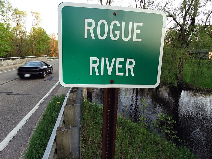 In this May 16, 2018 file photo the Rogue River flows underneath Algoma Ave. NE in Algoma Township, Mich. The Michigan DEQ is asking Wolverine World Wide to expand perfluoroalkyl and polyfluoroalkyl compounds, or PFAS, testing in the area. There's growing evidence that long-term exposure to the perfluoroalkyl and polyfluoroalkyl compounds, or PFAS, can be dangerous, even in tiny amounts. The Environmental Protection Agency is looking at how to respond to a public push for stricter regulation of the chemicals, in production since the 1940s. A decision is expected soon. (Garret Ellison/The Grand Rapids Press via AP)
