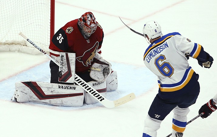 St. Louis Blues defenseman Joel Edmundson (6) sends the puck past Arizona Coyotes goaltender Darcy Kuemper (35) for a goal during the first period Thursday, Feb. 14, 2019, in Glendale. (Ross D. Franklin/AP)