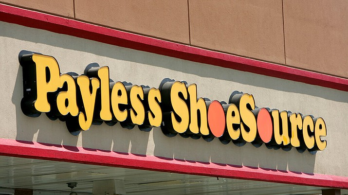This 2006, file photo shows a Payless store front is seen in Philadelphia. Paylesss ShoeSource is shuttering all of its 2,100 remaining stores in the U.S. and Puerto Rico, joining a list of iconic names like Toys R Us and Bon-Ton that have been shuttered in the last year. The Topeka, Kansas-based chain said Friday, Feb. 15, 2019 it will hold liquidation sales starting Sunday and wind down its e-commerce operations. (AP Photo/Matt Rourke, File)