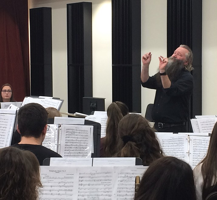 Rob Lubbers, band director at Dobson High School, asks high school students for their best during a rehearsal.