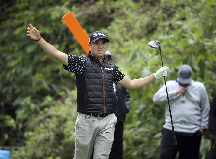 Justin Thomas and a marshal signal fore right on his drive on the 12th tee as rain-delayed first-round play continues in the Genesis Open golf tournament at Riviera Country Club in the Pacific Palisades area of Los Angeles Friday, Feb. 15, 2019. (Reed Saxon/AP)