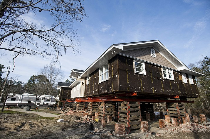 A travel camper sits in the driveway outside of a home in the process of being raised after being damaged by floodwaters from Hurricane Florence Friday, Feb. 1, 2019, in Conway, S.C. Multiple residents in the neighborhood near the Crabtree Swamp are currently living in campers as their homes are repaired. (Sean Rayford/AP)