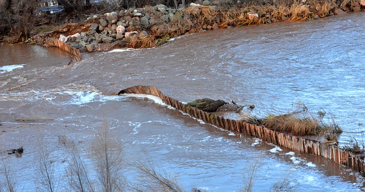 The 105-year-old Clarkdale dam on the Verde River breached Friday. VVN/Vyto Starinskas