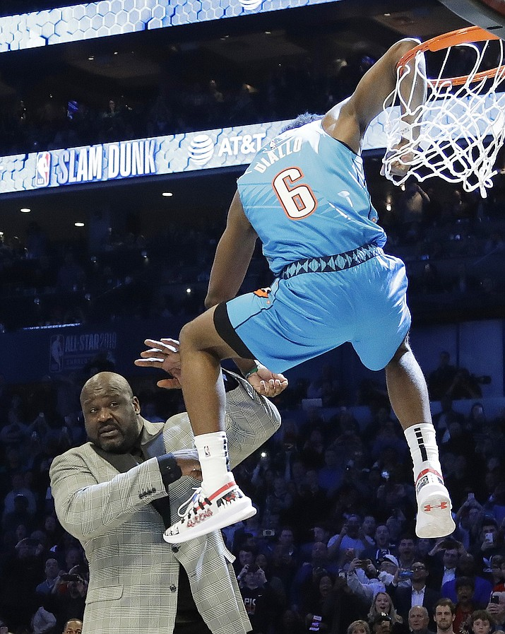 Oklahoma City Thunder Hamidou Diallo leaps over former NBA player Shaquille O'Neal during the All-Star Slam Dunk contest, Saturday, Feb. 16, 2019, in Charlotte, N.C. Diallo won the contest. (AP Photo)