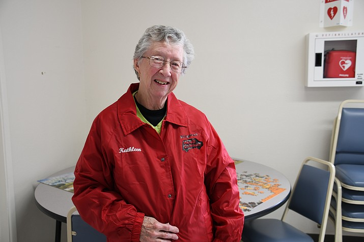Kathleen Caruso celebrated 10 years of being a bus driver for Meals on Wheels Friday and received a new jacket with the Meals on Wheels logo and her name. (Photo by Vanessa Espinoza/Daily Miner)