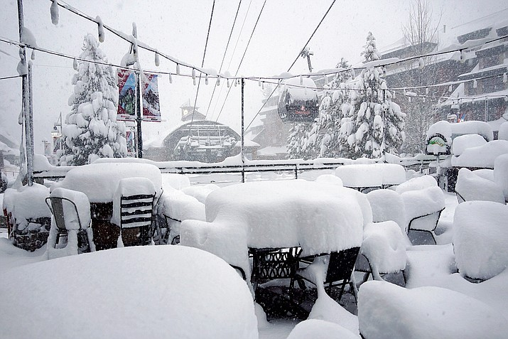 This Friday photo released by Heavenly Mountain Resort shows snow covering chairs and ski equipment at Heavenly Mountain Resort near South Lake Tahoe, Calif. (Duncan Kincheloe/Heavenly Mountain Resort via AP)