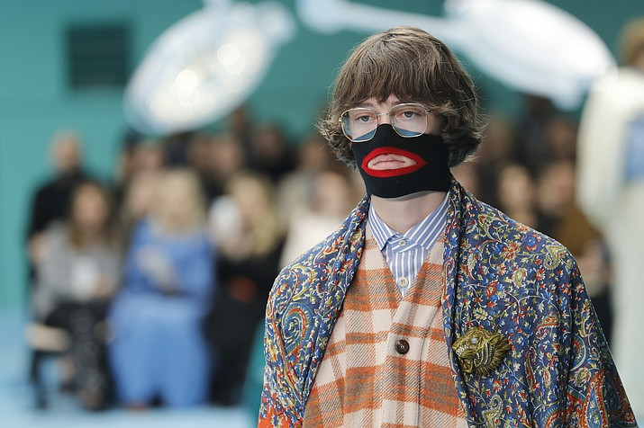 A model wears a creation as part of the Gucci women's Fall/Winter 2018-2019 collection, presented Feb. 21, 2018, during the Milan Fashion Week, in Milan, Italy. Gucci, which designed this face warmer, reminiscent of blackface prompted an instant backlash from the public and forced the company to apologize publicly on Wednesday, Feb. 6, 2019. (Antonio Calanni/AP, File)